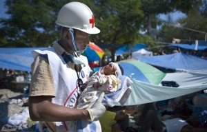 A Red Cross aid worker cradles an injured infant in Haiti in the aftermath of the Jan. 12 earthquake.