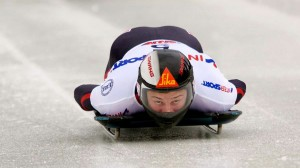 World champion Martins Dukurs slides down the track on his skeleton sled.